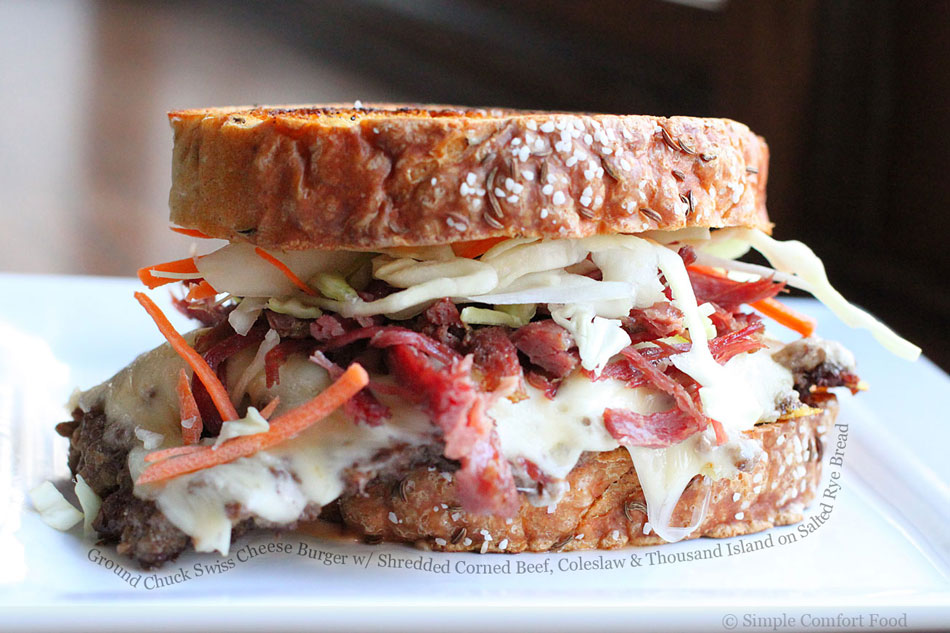 Ground Chuck Swiss Cheese Burger with Shredded Corned Beef, Coleslaw and Thousand Island on Salted Rye Bread