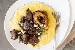 Guinness Braised Beef Shanks Over Creamy Polenta Sprinkled with Blue Cheese