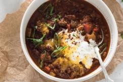 Guinness Spiked Irish Chili with Cheddar, Sour Cream and Green Onions