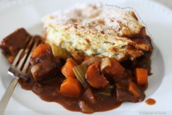 Hearty Irish Beef Stew with Crusty Parmesan Soda Bread Topping