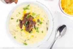 Hearty Loaded Potato Soup Topped with Crispy Bacon, Cheddar, Parsley and Chives