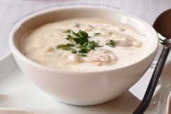 Hearty New England Clam Chowder Filled with Potatoes, Smokey Bacon and Tender Clams