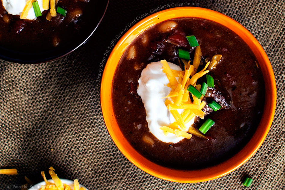 Hearty Short Rib Fajita Stew with Sour Cream, Cheddar and Green Onions