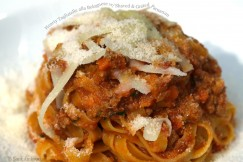 Hearty Tagliatelle alla Bolognese with Shaved and Grated Parmesan