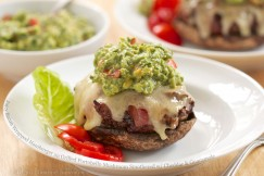 Juicy Bacon Wrapped Hamburger on Grilled Portobello Mushroom Smothered with Cheddar and Guacamole