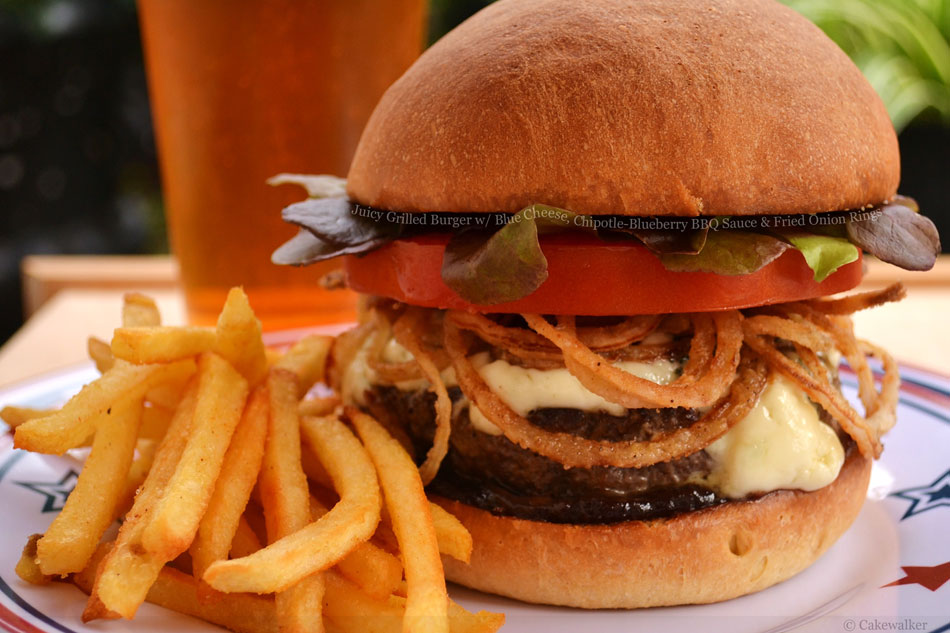Juicy Grilled Burger with Blue Cheese, Chipotle-Blueberry BBQ Sauce and Fried Onion Rings