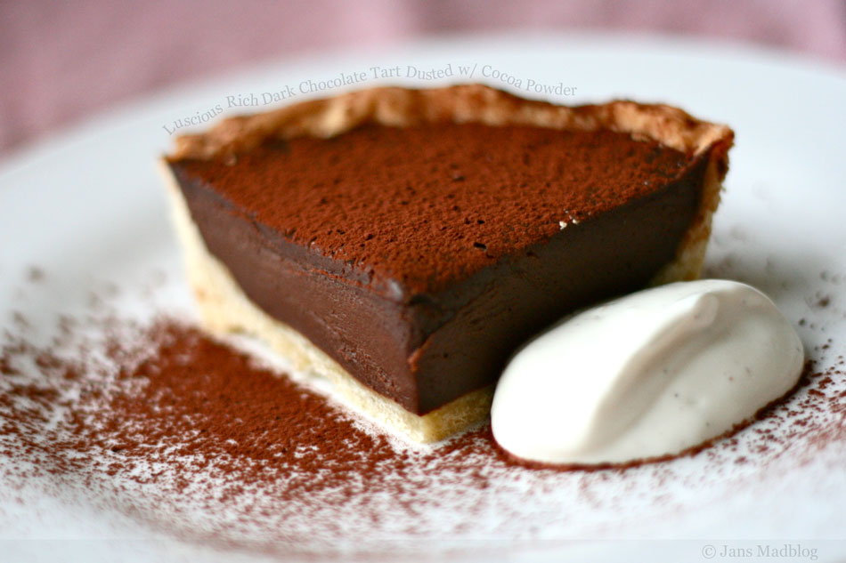 Luscious Rich Dark Chocolate Tart Dusted with Cocoa Powder