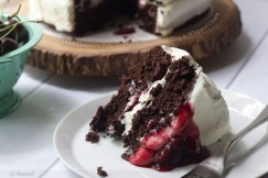 Moist Chocolate Cake with Cherry-Amaretto Filling and Whipped Cream
