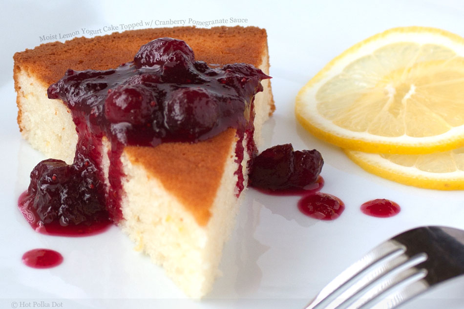 Moist Lemon Yogurt Cake Topped with Cranberry Pomegranate Sauce.