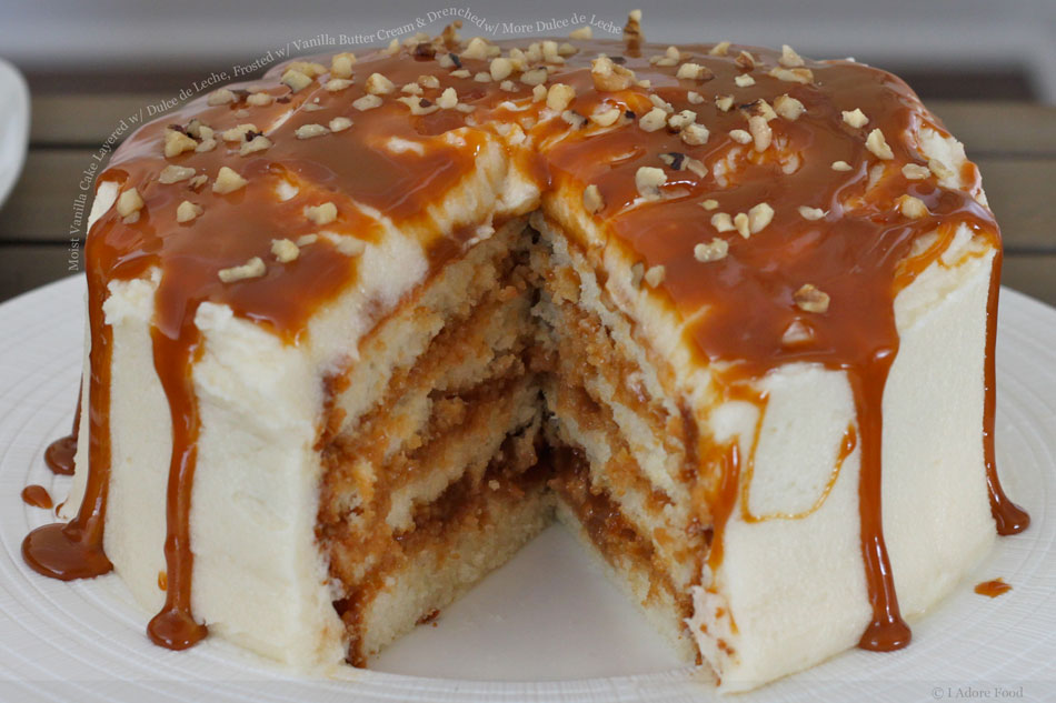 Moist Vanilla Cake Layered with Dulce de Leche, Frosted with Vanilla Butter Cream and Drenched with More Dulce de Leche