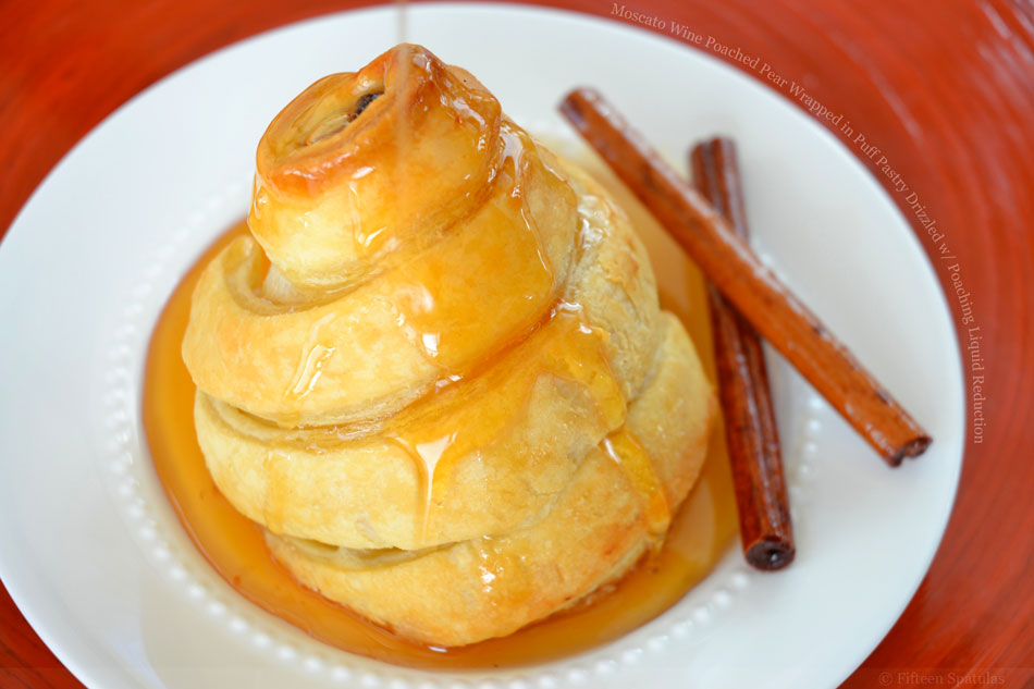 Moscato Wine Poached Pear Wrapped in Puff Pastry Drizzled with Poaching Liquid Reduction