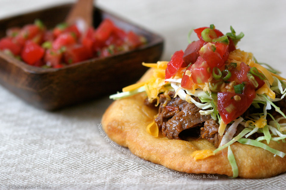 Navajo Fry Bread Taco With Shredded Beef Cheddar Cabbage And Salsa