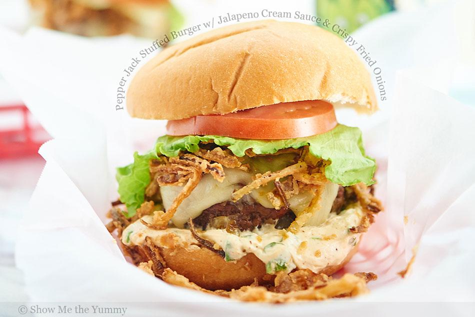 Pepper Jack Stuffed Burger with Jalapeno Cream Sauce and Crispy Fried Onions