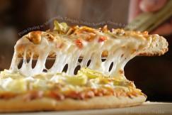 Pizza Oozing with Mozzarella, Taleggio, Italian Sausage, Onion and Artichoke
