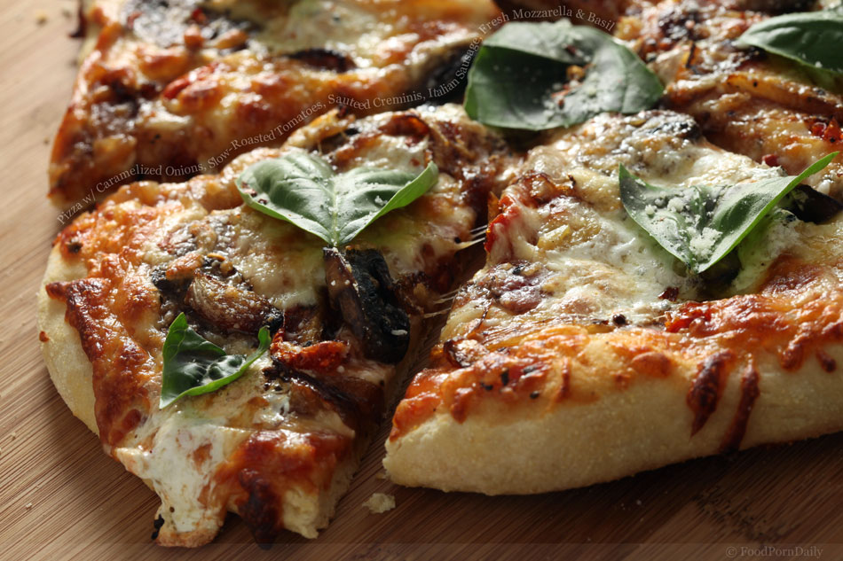 Pizza with Caramelized Onions, Slow Roasted Tomatoes, Sauteed Creminis, Italian Sausage, Fresh Mozzarella and Basil