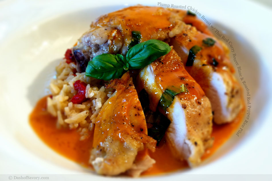Plump Roasted Chicken Breast with Thai Red Curry Beurre Blanc and Roasted Red Pepper Rice Pilaf