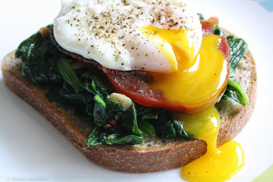 Perfectly Poached Egg with Sauteed Spinach and Tomato on Toast