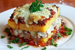 Polenta Layered with Hearty Ragu di Carne and Oozing Mozzarella and Parmesan