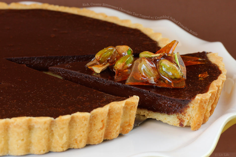 Rich, Creamy Bittersweet Chocolate Tart Topped with Crumbled Salted Pistachio Brittle