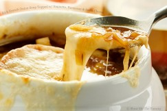 Rich French Onion Soup Topped with Baguette, Parmesan and Swiss Cheese