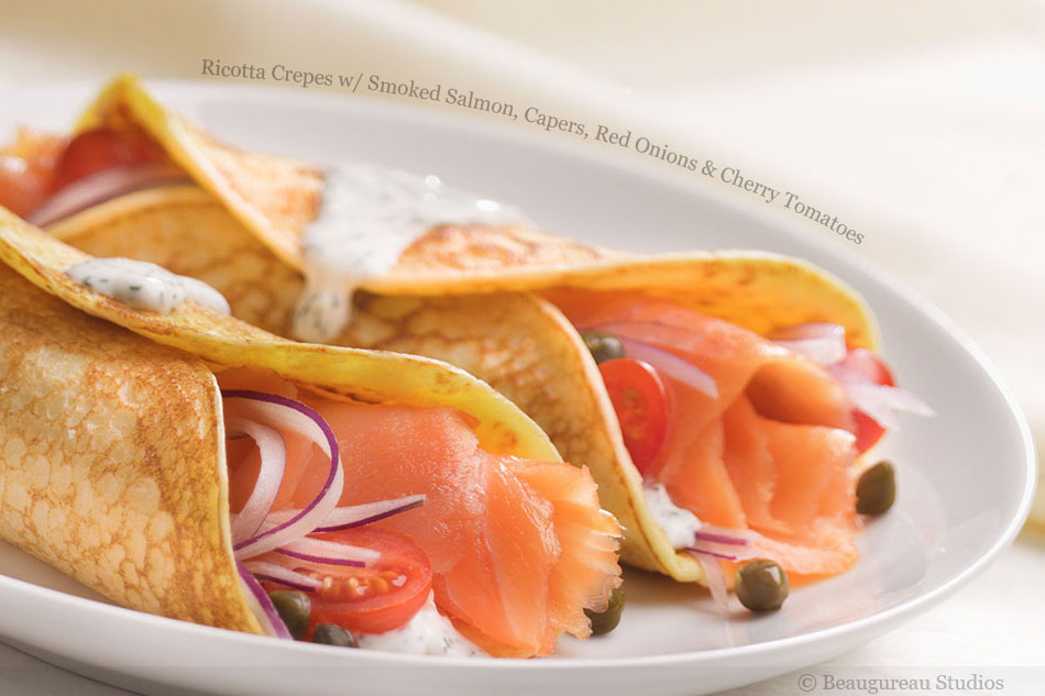 Ricotta Crepes with Smoked Salmon, Capers, Red Onions and Cherry Tomatoes