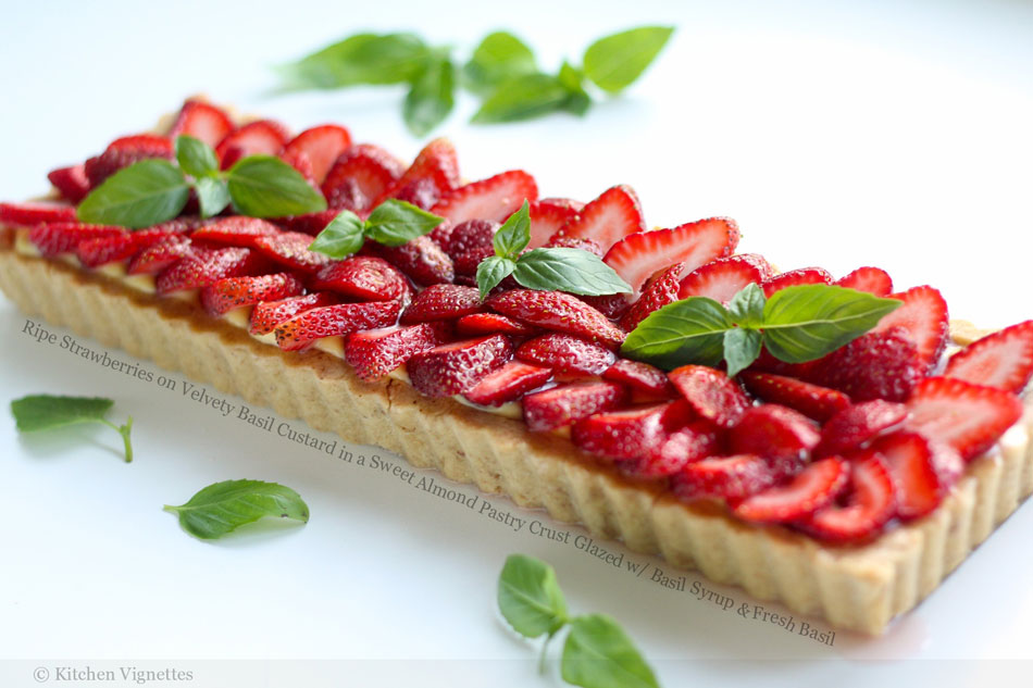Ripe Strawberries on Velvety Basil Custard in a Sweet Almond Pastry Crust Glazed with Basil Syrup and Fresh Basil