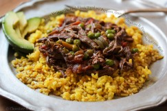 Ropa Vieja – Shredded Flank Steak with Peppers, Onions, Tomatoes and Peas Over Saffron Rice