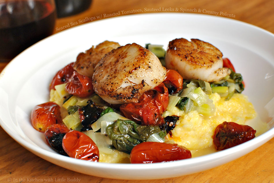 Seared Sea Scallops with Roasted Tomatoes, Sauteed Leeks and Spinach and Creamy Polenta