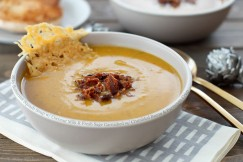 Silky Butternut Squash Soup with Coconut Milk and Fresh Sage Garnished with Crumbled Bacon and Parmesan Crisp