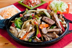 Sizzling Texas Style Chicken and Steak Fajitas with Sauteed Peppers and Onions