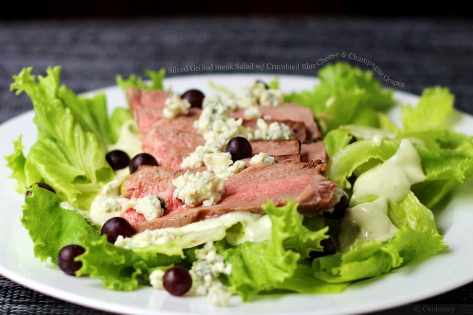 Sliced Grilled Steak Salad with Crumbled Blue Cheese and Champagne Grapes