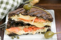 Smoked Salmon Reuben with Swiss Cheese, Sauerkraut and Spicy Caper Remoulade on Pumpernickel