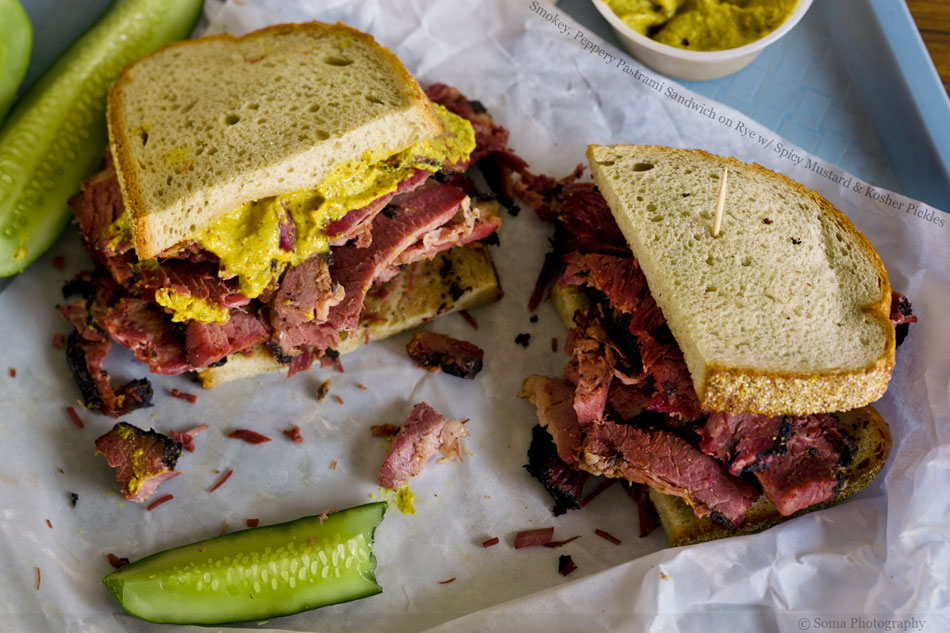 Smokey, Peppery Pastrami Sandwich on Rye with Spicy Mustard and Kosher Pickles