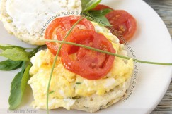 Soft Scrambled Eggs and Butter Fried Tomatoes on Zucchini Biscuits with Basil and Parmesan