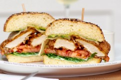 Southern Fried Chicken Sandwich with Pepper Jack, Smokey Bacon, Arugula, Tomato, Avocado Mash and Jalapeno Cream Sauce