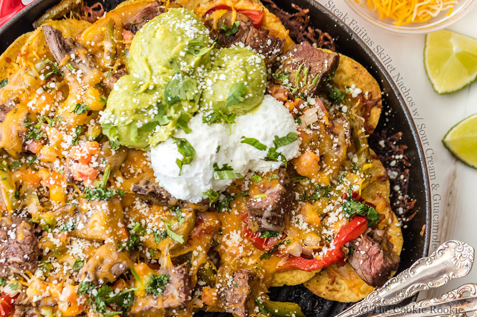 Steak Fajitas Skillet Nachos with Sour Cream and Guacamole