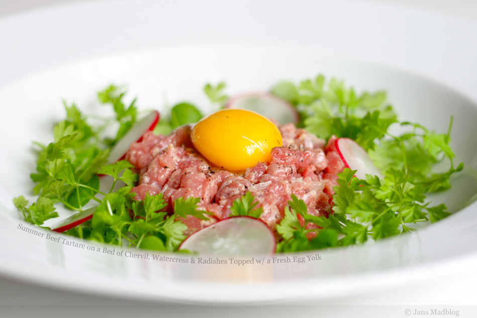 Summer Beef Tartare on a Bed of Chervil, Watercress and Radishes Topped with a Fresh Egg Yolk