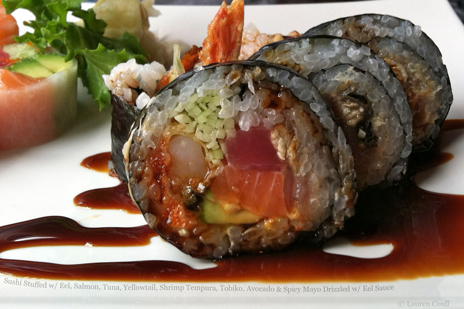 Sushi Stuffed with Eel, Salmon, Tuna, Yellowtail, Shrimp Tempura, Tobiko, Avocado and Spicy Mayo Drizzled with Eel Sauce
