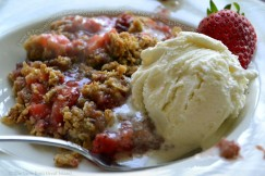 Sweet and Tangy Strawberry Rhubarb Crisp with Hazelnut Oatmeal Topping and Vanilla Ice Cream