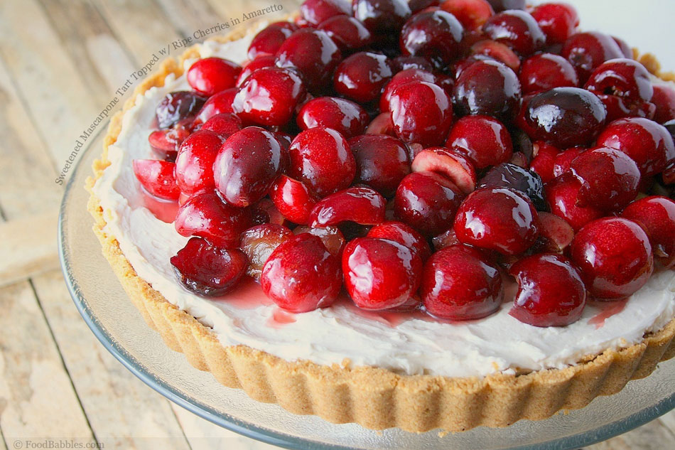 Sweetened Mascarpone Tart Topped with Ripe Cherries in Amaretto Syrup