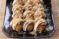 Takoyaki – Japanese Street Dumplings Filled with Octopus and Cabbage Topped with Takoyaki Sauce, Bonita Flakes and Mayo