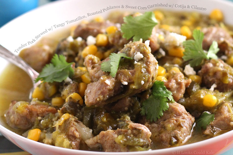 Tender Pork Stewed with Tangy Tomatillos, Roasted Poblanos and Sweet Corn Garnished with Cotija and Cilantro