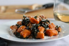 Tender Sweet Potato Gnocchi with Chicken Italian Sausage and White Wine Wilted Kale