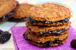 Thin, Crispy Oatmeal Cookie Sandwiches Filled with Blackberry Jam