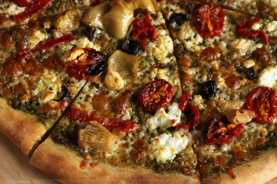 Thin Crust Pizza with Artichokes, Feta, Sun-Dried Tomatoes, Kalamata Olives and Peppers