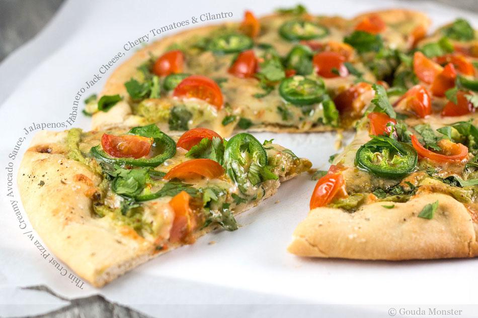 Thin Crust Pizza with Creamy Avocado Sauce, Jalapenos, Habanero Jack Cheese, Cherry Tomatoes and Cilantro