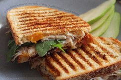 Turkey Panini on Buttery Crusty Bread with Sharp Cheddar, Smokey Bacon and Arugula