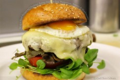 Wagyu Beef Burger with Cheddar, Sunny-Side Up Egg, Watercress, Tomato and Mushrooms